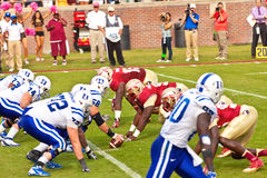 College Football. Tallahassee, FL - October 27, 2012:  College football game featuring the Florida State University Seminoles defense vs Duke University Blue Royalty Free Stock Photo