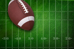 College football on textured field backgrou Stock Photography