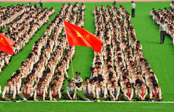 College freshmen military training. In China, most Freshmen in collage take a Obligatory course- Military Training.The freshmen are sitting on the playground at Royalty Free Stock Image