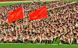 College freshmen military training. In China, most Freshmen in collage take a Obligatory course- Military Training.The freshmen are sitting on the playground at Stock Photography