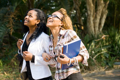 College friends. Two young happy african female college students friends classmates going to school classroom together Royalty Free Stock Photos