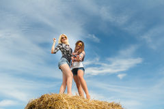 College friends having fun on harvested farm field Royalty Free Stock Photography