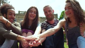 College friends holding hands together. stock video footage