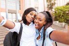 College friends selfie together. Happy african college friends taking selfie together royalty free stock photo
