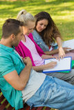 College friends sitting on campus bench Royalty Free Stock Photos