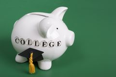 College Fund. Saving for college - pigy bank with diploma cap Royalty Free Stock Photography