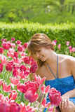 College Girl. Smelling the Pretty Pink Tulips Royalty Free Stock Photography
