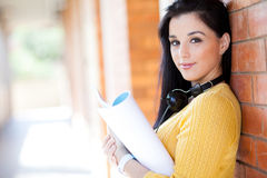 College girl. Attractive young college girl reading book Stock Photography