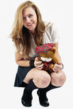 College girl with her teddy bear Royalty Free Stock Photo