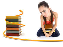 College girl holding books in her lap Stock Images