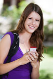 College girl holding cell phone Stock Photos