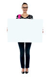 College girl holding white ad board Royalty Free Stock Photos
