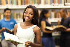 College girl library. Beautiful african american college girl in library Stock Photography