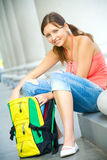 College girl opening backpack Stock Images
