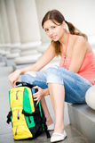 College girl opening backpack Stock Image