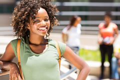 College girl outdoors campus. Cheerful african college girl outdoors on modern campus Stock Image