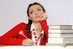 College girl with pile of books Stock Photo