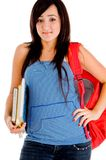 College girl posing with bag and books