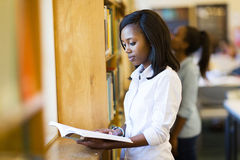 College girl reading book stock images