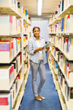 College girl reading in library Royalty Free Stock Photos