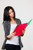 College girl reading notes. Slim pretty college girl reading notes, focus on face Royalty Free Stock Photos