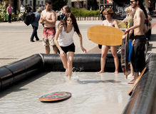 College girl surf rides in the city center. SZCZECIN, POLAND - MAY 23, 2014: Juwenalia, is an annual students' holiday in Poland, usually celebrated for three Stock Photo