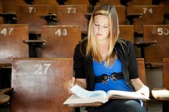 College Girl with Text Book Royalty Free Stock Images