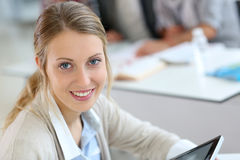 College girl websurfing on tablet Royalty Free Stock Photos