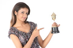 College girl winning a gold trophy Royalty Free Stock Photos