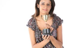 College girl winning a gold trophy. Picture of an attractive college girl winning a gold trophy Stock Photos