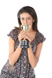 College girl winning a gold trophy. Picture of an attractive college girl winning a gold trophy Royalty Free Stock Images