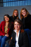 College girls looking professional. Four young students in professional dress Royalty Free Stock Photos