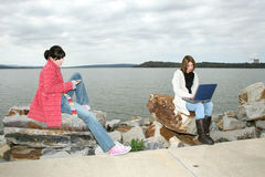 College Girls Outside with Laptop royalty free stock image