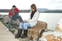 College Girls Outside with Laptop Royalty Free Stock Photography