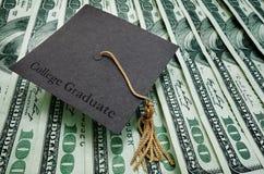 College Graduate. Cap on assorted hundred dollar bills Stock Image