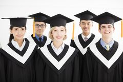College graduate at graduation with classmates Stock Photography