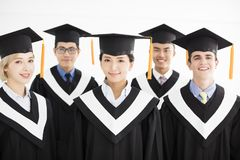 College graduate at graduation with classmates Royalty Free Stock Photography