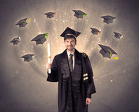 College graduate with many flying hats Royalty Free Stock Image