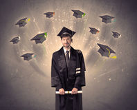 College graduate with many flying hats Royalty Free Stock Photography