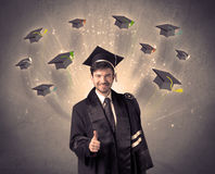College graduate with many flying hats Stock Image