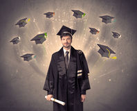 College graduate with many flying hats Royalty Free Stock Photo