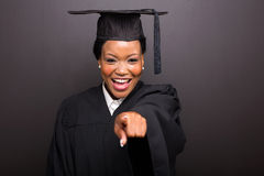 College graduate pointing royalty free stock photo