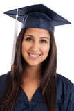College graduate portrait. Portrait of a beautiful mixed race Japanese Mexican college graduate wearing cap and gown isolated on white Royalty Free Stock Photography