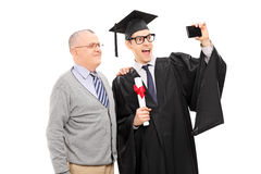 College graduate taking a selfie with his father Royalty Free Stock Photo