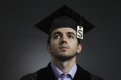 College graduate with tuition price tag, horizontal Royalty Free Stock Photo