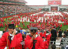 College Graduates. Rutgers University graduates file out of Rutgers Stadium in Piscataway, New Jersey, on May 15, 2011, following Rutgers 245th Annual Stock Images