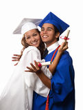 College graduates in cap and gown Stock Photo