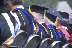 College graduates celebrating, royalty free stock photography