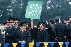 College graduates with sign,  Royalty Free Stock Image