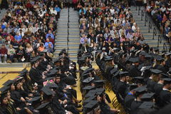 College graduation. With cap and gown Stock Photography